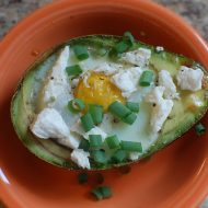 baked egg in an avocado cup